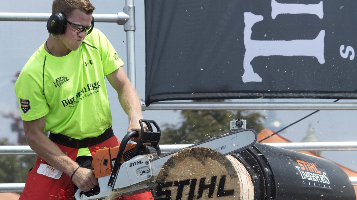 Stirling Hart of Maple Ridge, B.C., powers his way to his first title at the STIHL Timbersports Canadian Championship at the Honda Indy in Toronto, Sunday, July 20, 2014.  Hart earned one of four spots on Team Canada to compete at this year's World Championship in Innsbruck, Austria, Nov. 14-15.  The Canadian Press Images PHOTO/STIHL Timbersports
